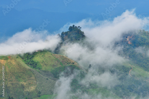Natural landscape view with mists sea at sunrise. Mists in the cove. Mountain of fog, sun and win. - 236455851
