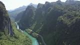 bird eye flight narrow deep canyon with river and road - 236476418