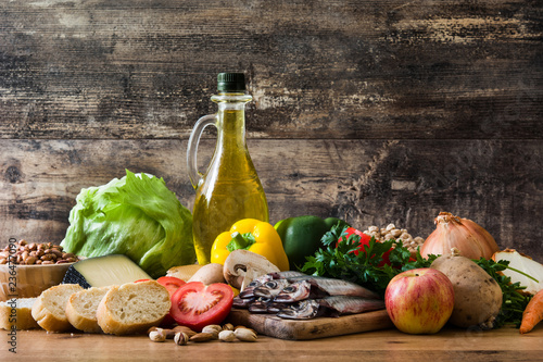 Foto Murales Healthy eating. Mediterranean diet. Fruit,vegetables, grain, nuts olive oil and fish on wooden table