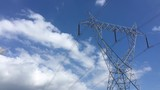 Timelapse of Moving clouds above the high tension electric tower in Paddy fields of India. - 236495272