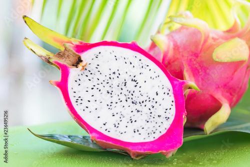 Fresh, tasty tropic, exotic dragon pitahya dragon fruit near palms