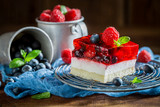 Closeup of homemade cake with jelly and berry fruits - 236505605
