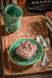 Closeup of tasty cake and coffee with old books - 236505655