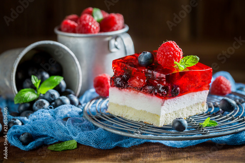 Closeup of homemade cake with jelly and berry fruits