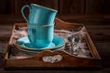 Blue rustic coffee cup and a plate on wooden tray - 236505819