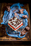 Cake with jelly, chocolate chips and fruits on wooden table - 236505865