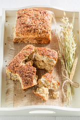 Healthy and delicious bread with wheat on white tray