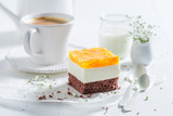 Closeup of delicious cake with jelly and served with coffee - 236506296
