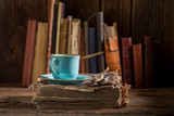 Rustic coffee in blue porcelain on book in library - 236506631