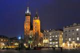 Gothic basilica of Virgin Mary (Kosciol Mariacki) on the main market square (Rynek Glowny) at night, Cracow, Poland. - 236506870