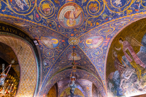 Leinwanddruck Bild The interior of the Latin Calvary Chapel in the Church of the Holy Sepulchre, decorated with the colorful mosaic patterns and icons, Jerusalem Israel.