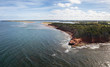 Aerial panoramic view of a beautiful rocky shore on the Atlantic Ocean. Taken in Cabot Beach Provincial Park, Prince Edward Island, Canada.