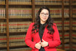 Young attractive professional woman, woman in law library,/