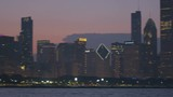 Chicago - April 2017: Illuminated panning motion view at sunset of Sears Tower city Skyscrapers and skyline Lake Michigan Illinois USA RED EPIC  - 236544087