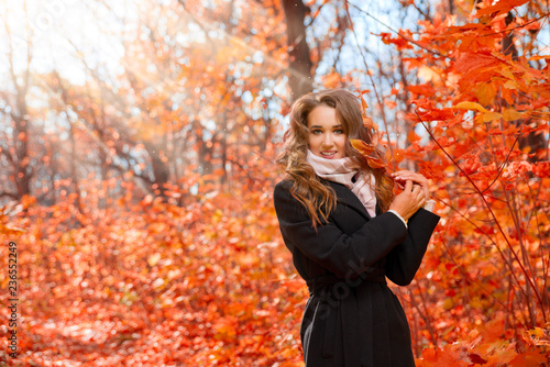 Young girl in autumn forest - 236552249