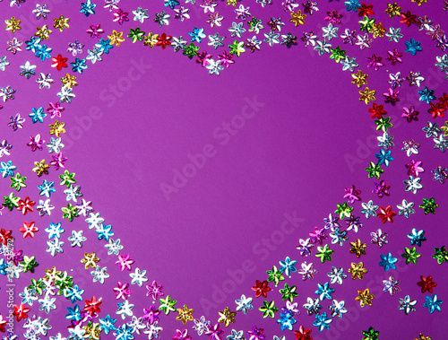 The background is a proton purple with small decorative elements in the form of flowers. In the center of the background is a place for text in the form of a heart. - 236556272
