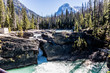 Water flowing over and under the Natural Bridge, Yoho National Park, British Columbia, Canada