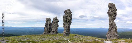 Magnificent panorama with a view of the Manpupunyur stone idols in the Northern Urals of Russia. - 236576698