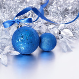 Christmas border with blue balls and ribbon on silver background square