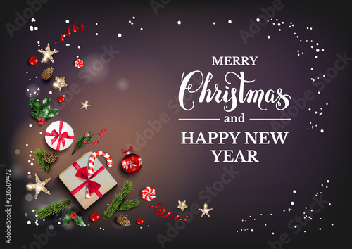 Holiday card with Christmas decorations and balls, stars, gift boxes, fir tree branches on dark background. Christmas festive template. - 236589472