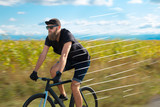 Casual hipster cyclist riding bicycle with high speed concept - 236592678