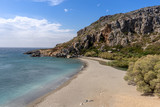 Landscape at Preveli beach on the island of Crete, Greece with a wide view over the mountains with a bay and a beach in the front