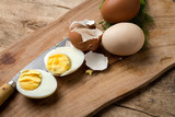 Baked eggs on wooden background - 236607247