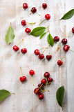 Local cherry on white rustic background