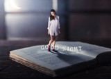 Good night concept with young woman reading book - 236661845