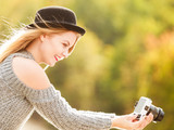 Woman in hat taking outdoor pictures