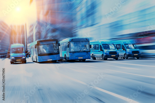 buses move along a multi-lane avenue in the city