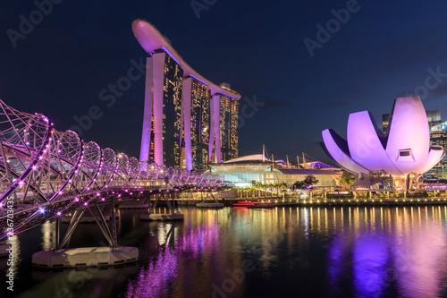 Singapore, Singapore - October 17, 2018: Cityscape at dusk with Marina Bay Sands, Modern Art Museum and Helix Bridge