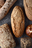 top view of several rustic homemade breads on decorated background