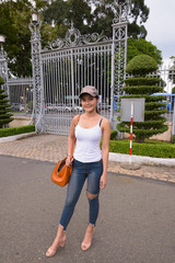 Full length shot of young beautiful Asian tourist woman standing