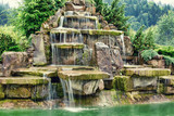 Artificial waterfall, outdoor background