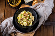 Reginette noodles in cream sauce with fresh chanterelles and capers - 236739039