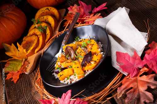 gratinated vegetarian pumpkin with barley groats, plums and thyme - 236739094