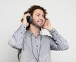 Enjoying the sound of music. Studio portrait of handsome young man with headphones.