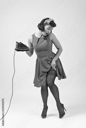 fototapeta na ścianę Beautiful woman in pin up style with vintage phone.