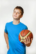 portrait of a teenage boy with a basketball ball on a white background, isolate