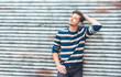 Beautiful man posing, handsome guy with colorful sweatshirt