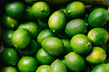 Fresh green limes background