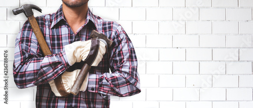 Worker is building a brick wall. - 236788476