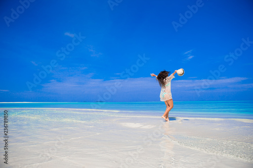 Leinwanddruck Bild Young beautiful woman on beach during tropical vacation