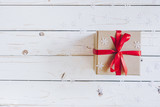 Brown gift box and Christmas presents on white wooden table background. - 236796054