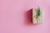 Brown gift box on the pink background. Minimal styled holiday card with copy space. - 236796219