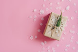 Brown gift box on the pink background with christmas decoration. Minimal styled holiday card with copy space. - 236796258