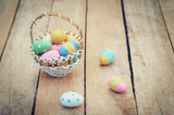 Colorful easter eggs in basket on wooden table win copy space. - 236796808