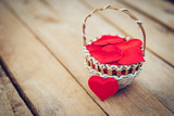 Red heart in basket on wooden table for valentine day and love concept with copy space. - 236796864