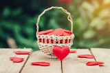 Red heart in basket on wooden table for valentine day and love concept with copy space. - 236796891